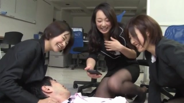 These naughty Asian office ladies are giving this horny co worker quite a coffee break when they get him naked and give him a foot job with their stocking covered feet on his hard cock! In true CFNM, the is stroked in this mfff group and he is more than t
