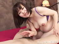 Pregnant Japanese hottie An Mizuki likes to play with cock.