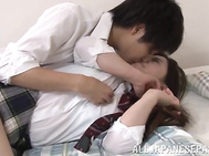 Mischievous Japanese schoolgirl with big tits seduces her classmate by showing off her legs and pussy upskirt.