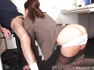 She bends over and the guy behind her pulls down her panties and licks her pussy from behind.