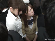 Two Asian lesbian teens Uta Kohaku, and Karen Hazuki in a public place.