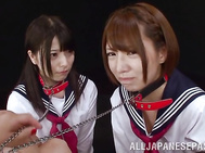 Two horny little lesbians Eria Yuria and Misa Ai lick and finger pussies.