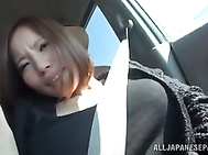 Lusty Japanese milf flirts with her sexy boyfriend in a car, revealing her juicy goodies and showing her intention to have steaming sex.