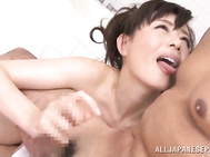Horny and very naughty, Japanese milf, Eriko Miura, goes nasty with this guy's dick while in the tub together, stroking it with her warm hands while moaning and gently touching it over her perky tits and nice ass.