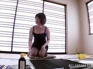 Very pretty Japanese hottie in fancy black stockings gets teased by her horny impressive lover on the floor.