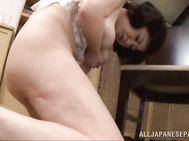A mature Asian woman, Chizubu Terashima in white lingerie is horny and starts to play with herself taking off her bra and squeezing her big saggy boobs.