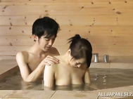 This hot mature Asian lady is giving some hand work to her guy.