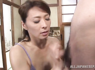 Very horny Japanese mature lady Hisae Yabe flirts with her new young boyfriend, seducing him for sex.