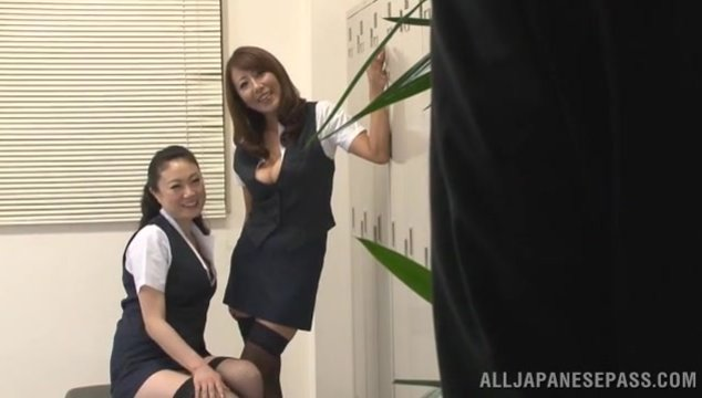 Two crazy Japanese teachers in black stockings share and ride cock.