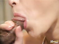 She grabs them both and goes back and forth with her warm, wet mouth, sucking and slurping them both and getting a double blast to her mouth of their hot spunk so she can swallow it.