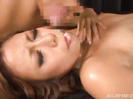 She gets a load of cum on her face after sucking him off and he is enjoying fingering her slit and has pushed her panties aside so he can get to her juicyness