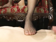 Sora Aoi is a beautiful Asian dominating chick! She is extra sexy in her black lingerie and fishnet stockings! Her slave is naked on the floor and she shows him her hairy pussy before she plays with his cock with her delicate feet.