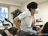 Appetizing Asian milf works as a dentist, and she looks sexy and arousing, so her patient can´t stay still in the dental chair and starts to flirt with her and grabs her juicy boobs.