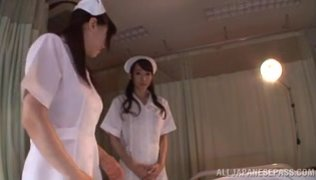 Lusty Asian nurses Caire Hasumi and Anri Okita play with cock.