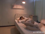 Sexy Asian nurse Shiori Kamisaki gives head and a nice tit fuck.