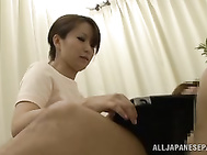 Skillful Japanese mature nurse gives her patient a perfect blow.