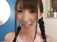 Pigtailed Asian teen Yuuki Itano is tickled by sex toys.