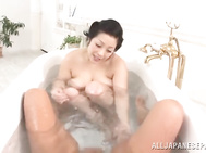 Naked Japanese lady Minako Komukai is in the tub with the POV guy and she is busy giving him a nice shower with massage.