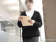 Insatiable Japanese milf gives head in the office.