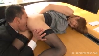 Pretty Japanese office lady Akari Asahina looks hot in her black stockings and her office suit.