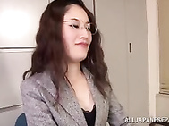 Chick in office suit makes facesitting and plays with cock.