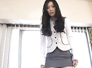 This lovely Asian office worker is sexy in her office suit.