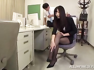 Horny Japanese office lady Rina Fukada gives incredible footjob.