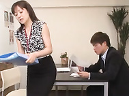 Hot mature chick in office suit Ai Komori pussy stimulation.