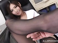 Sweet Japanese office lady Yuna Shiina teases cock with her lovely feet.