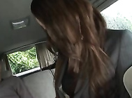 Yuu Kanda Asian babe is in the car with black stockings.