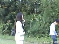 Innocent looking Asian mature chick fucked doggie fashion outdoors.