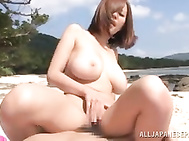 She is on the beach when her guy shows up and he exposes her big tits to fondle and fuck! She sits on his face for a cunt licking before mounting him for a hard cock ride in public.