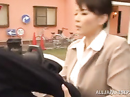 Hot Japanese mature milf spreads legs in a car for pussy plowing.