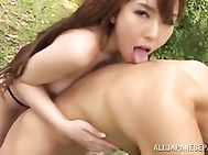 Gorgeous long-haired Japanese milf Yui Hatano plays with her boyfriend outdoors.