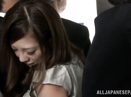 Impressive and very sex, Japanese beauty lifts her skirt, letting the guy reach her hairy pussy with his hand, finger fucking her pretty well and making her moan like never before.
