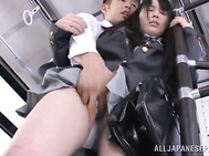 While the bus is moving to its destination, this guy is moving his hands up Mana Katase's schoolgirl skirt, making his way to her pantied bottom and massaging her through it.